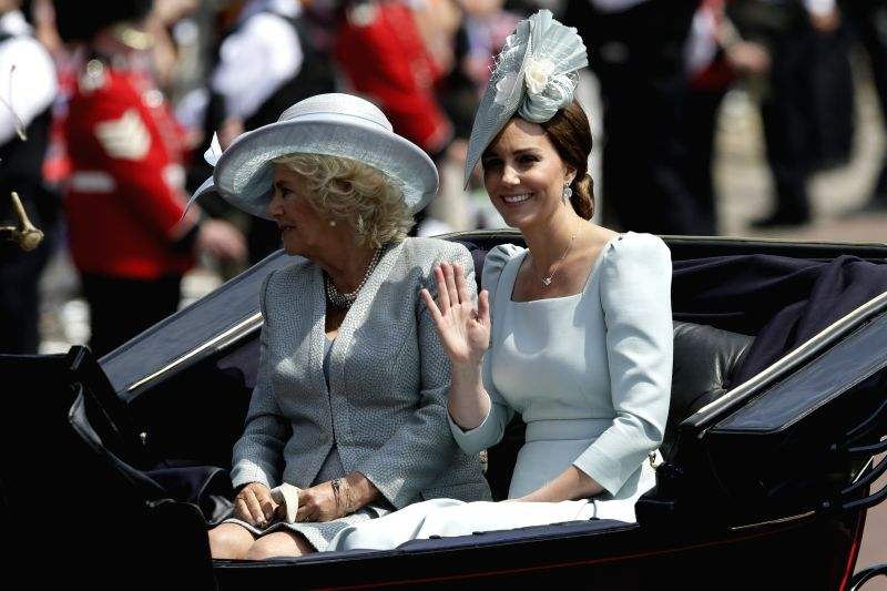 LONDON, June 9, 2018 - Catherine, Duchess of Cambridge (R) and Camilla, Duchess of Cornwall return in a horse-drawn carriage to Buckingham Palace during the Trooping of the Colour ceremony to mark ...