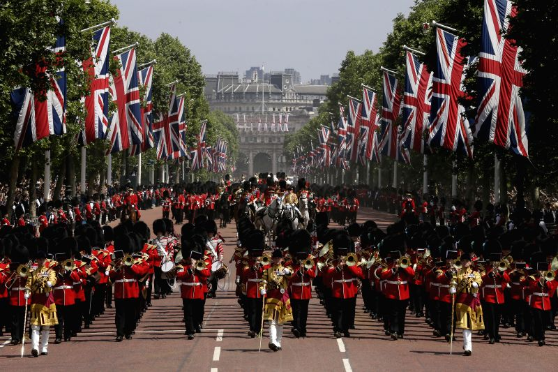 LONDON, June 9, 2018 - Soldiers march down the Mall escorting Queen Elizabeth II's carriage (C) to Buckingham Palace during the Trooping of the Colour ceremony to mark Queen Elizabeth II's 92nd ...