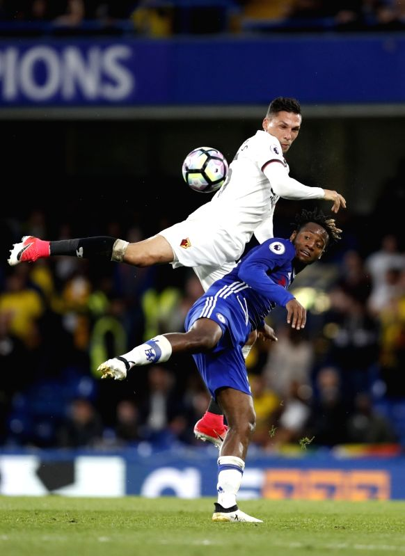LONDON, May 16, 2017 - Michy Batshuayi (R) of Chelsea vies with Jose Holebas of Watford during the English Premier League match between Chelsea and Watford at the Stamford Bridge Stadium in London, ...