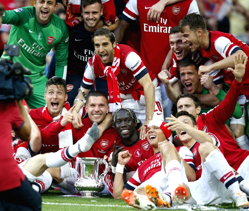 Players of Arsenal celebrate with the trophy after FA Cup final between Arsenal and Hull City at Wembley Stadium in London, Britain, on May 17, 2014. Arsenal ended ...