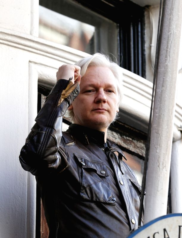 LONDON, May 19, 2017 - Wikileaks founder Julian Assange gestures on the balcony of the Ecuadorean embassy in London, Britain, on May 19, 2017. Julian Assange said on Friday that Sweden's decision to ...