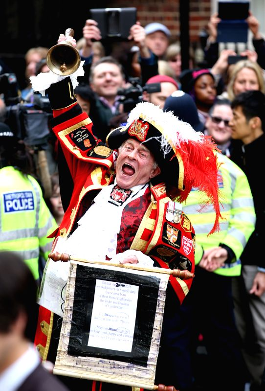 A town crier announces the birth of the royal baby outside St. Mary's Hospital in London, on May 2, 2015. Britain's Duchess of Cambridge Kate gave birth to a girl on ...
