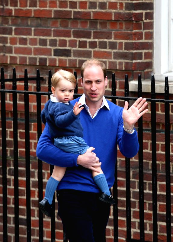 Prince William, Duke of Cambridge, holding Prince George arrive at St. Mary's Hospital after Catherine, Duchess of Cambridge, gave birth to a baby girl here in London, ...