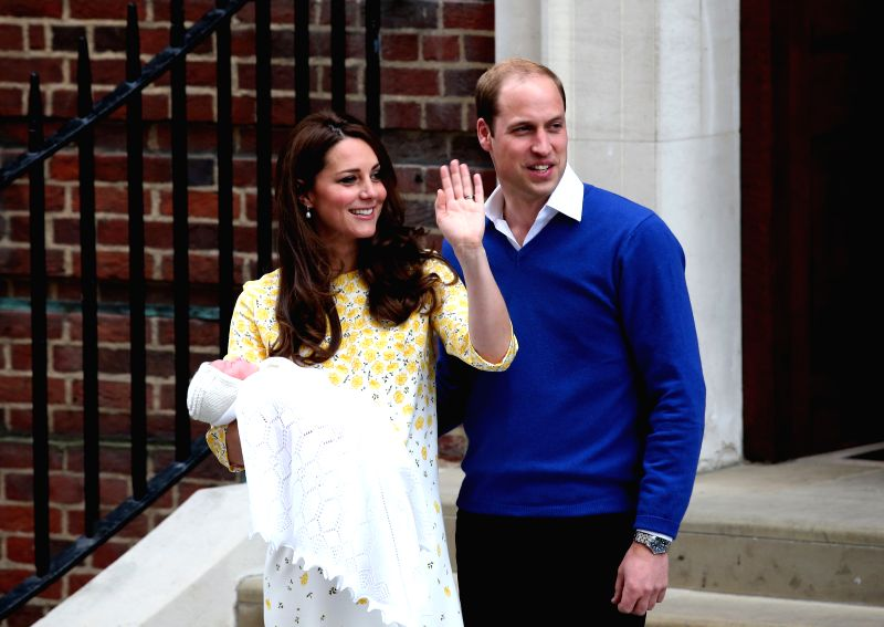 The newborn baby girl makes her first appearance to the public with the Duke of Cambridge and the Duchess outside St. Mary's Hospital in London, on May 2, 2015. ...
