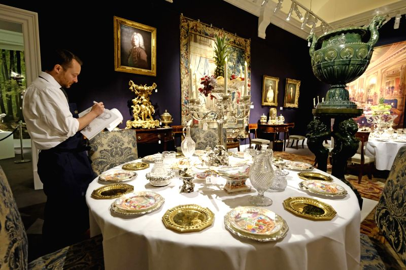 LONDON, May 20, 2017 - A Sotheby's staff member checks the collection of objects from the Belgravia home of Lord Ballyedmond presented in the Sotheby's auction house sale which recalls the ...