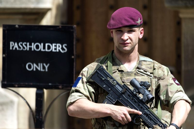 LONDON, May 24, 2017 - An armed soldier stands guard outside the Houses of Parliament in London, Britain, on May 24, 2017. British Prime Minister Theresa May announced Tuesday night that the ... - Theresa May