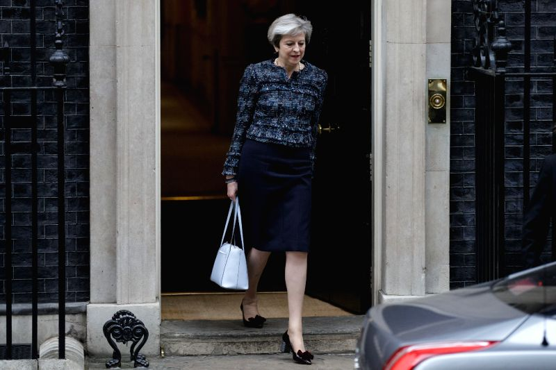 LONDON, May 3, 2017 - British Prime Minister Theresa May leaves 10 Downing Street for Buckingham Palace where she is expected to meet Britain's Queen Elizabeth II to ask permission for the ... - Theresa May