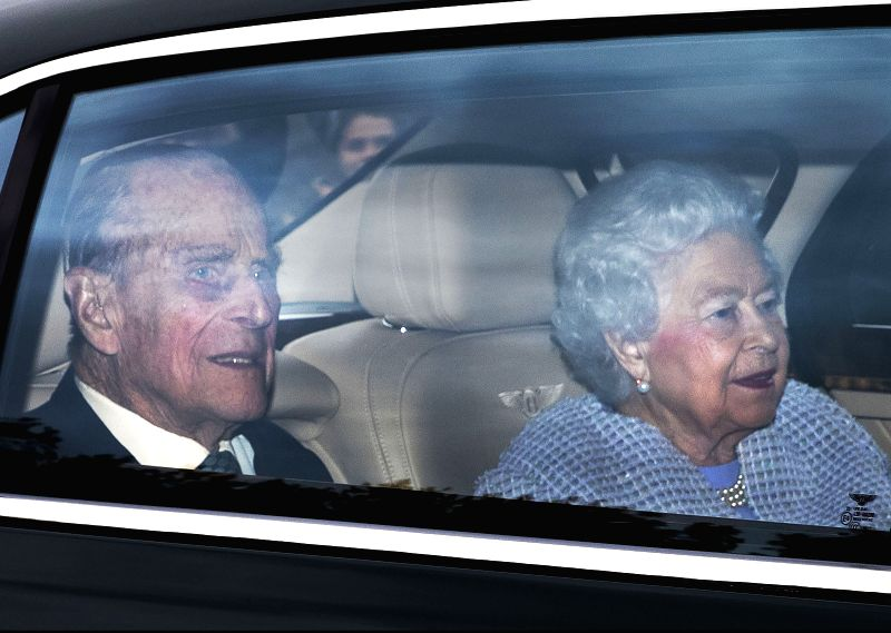 LONDON, May 4, 2017 - British Queen Elizabeth II and her husband Prince Philip (L), the Duke of Edinburgh, arrive back at Buckingham Palace in London, Britain, on May 4, 2017. British Queen Elizabeth ...