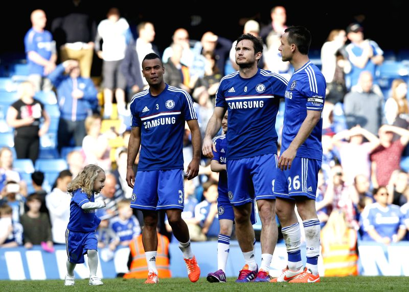 Ashley Cole (L), Frank Lampard (C) and John Terry of Chelsea acknowledge the crowd following the Barclays Premier League match against Norwich at Stamford Bridge ...