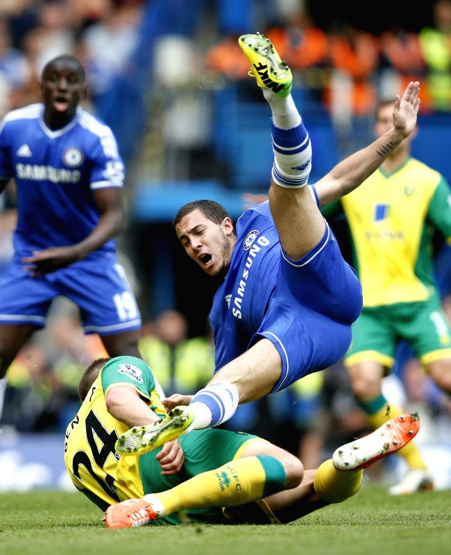 Eden Hazard (Top) of Chelsea clashes with Russell Martin of Norwich during the Barclays Premier League match at Stamford Bridge Stadium in London, Britain on May 4, ...