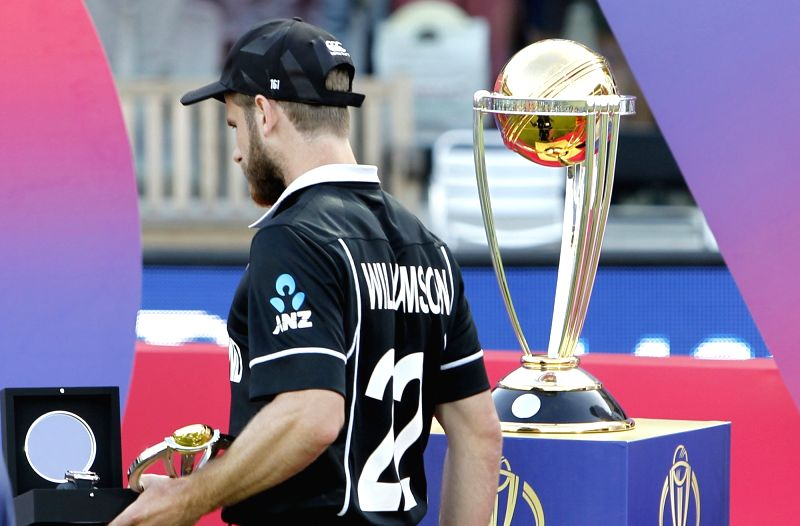 London: New Zealand captain Kane Williamson walks by the World Cup during the 2019 World Cup presentation ceremony at Lord's in London on July 15, 2019. (Photo: Surjeet Yadav/IANS)