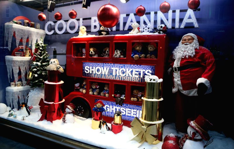 Photo taken on Nov. 19, 2014 shows a Christmas showcase in Covent Street, Piccadilly Circus of London, Britain.