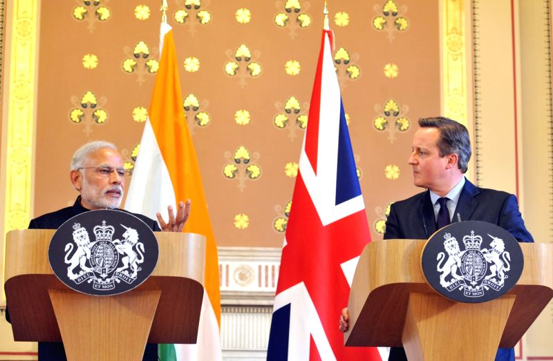 : London: Prime Minister Narendra Modi delivers his statement to the media with the Prime Minister of United Kingdom (UK), David Cameroon, at Foreign and Commonwealth Office, in London on Nov. 12, ... - Narendra Modi