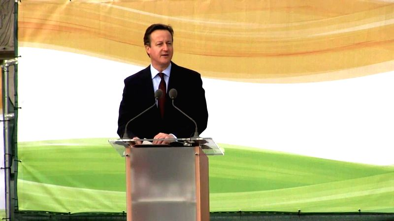 London (UK): British Prime Minister David Cameron addresses during a programme organised to unveil a nine feet high bronze statue of Mahatma Gandhi at the Parliament Square in London, UK on March 14, ... - David Cameron