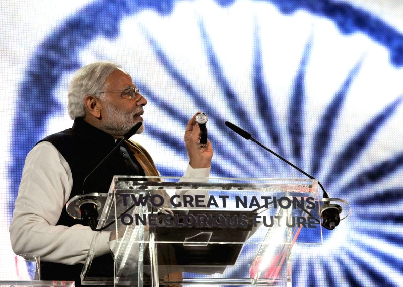 : London (UK): Prime Minister Narendra Modi addresses at Wembley Stadium, in London on Nov 13, 2015. (Photo: IANS/PIB). - Narendra Modi