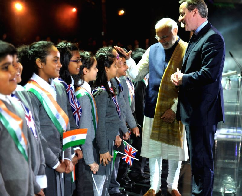 London (UK): Prime Minister Narendra Modi and the Prime Minister of United Kingdom (UK), David Cameroon interact with school students at Wembley Stadium, in London on Nov 13, 2015. - Narendra Modi