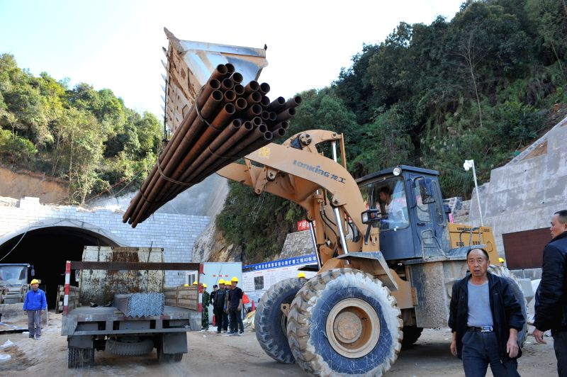 Rescuers unload the rescue supplies at the entrance of a collapsed expressway tunnel under construction in Longyan City, southeast China's Fujian Province. An rescue channel was opened at ...