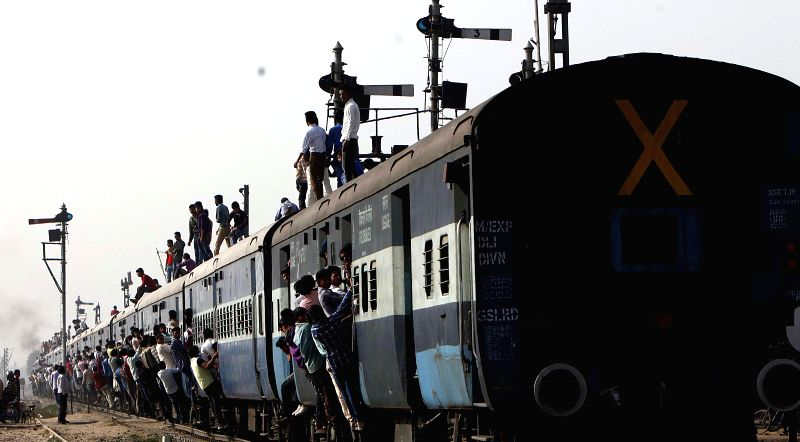 An overcrowded train departs from Loni of Uttar Pradesh's Ghaziabad on Feb 26, 2015. Union Railways Minister Suresh Prabhakar Prabhu Thursday presented the Railway Budget 2015-16 at the ... - Suresh Prabhakar Prabhu Thursday