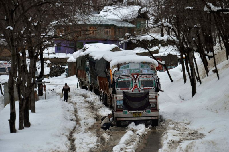 Lorries get stuck in snow-covered road; in Baramulla, on Feb 2, 2019.