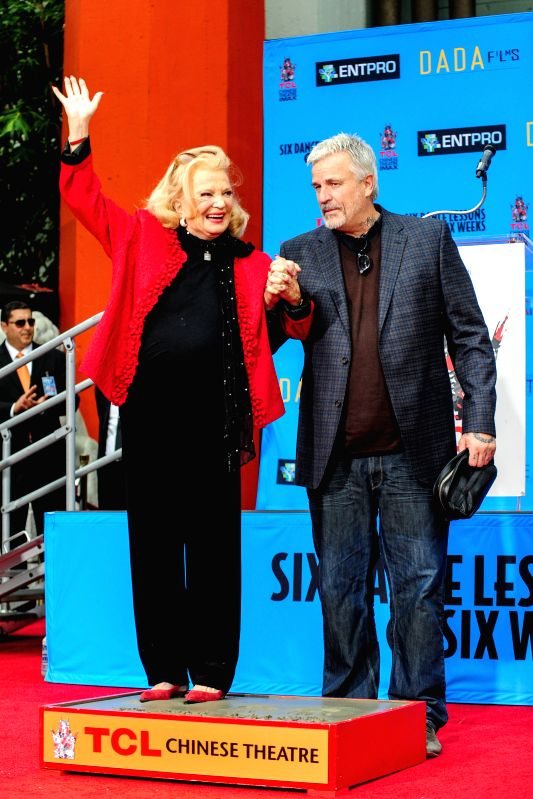 Los Angeles: American actress Gena Rowlands (L) poses at her hand and footprint ceremony outside the TCL Chinese Theater in Hollywood, the United States, Dec. 5, 2014.