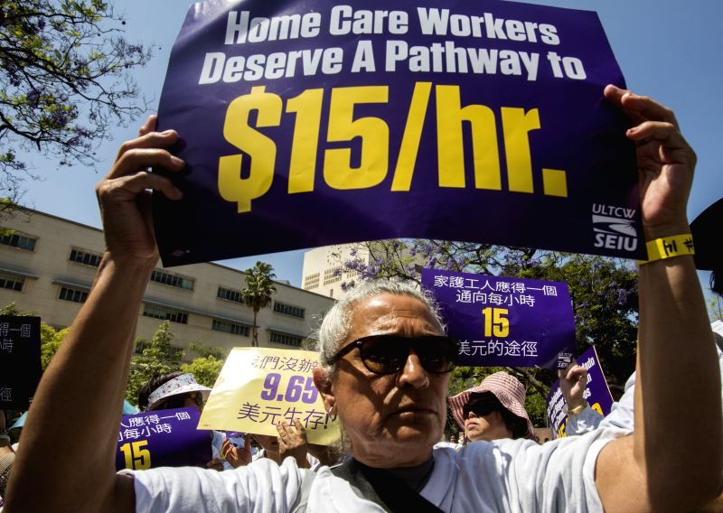 A man takes part in a rally for better wages in Los Angeles, April 14, 2015. The union representing home care workers demanded better wages as many of those ...