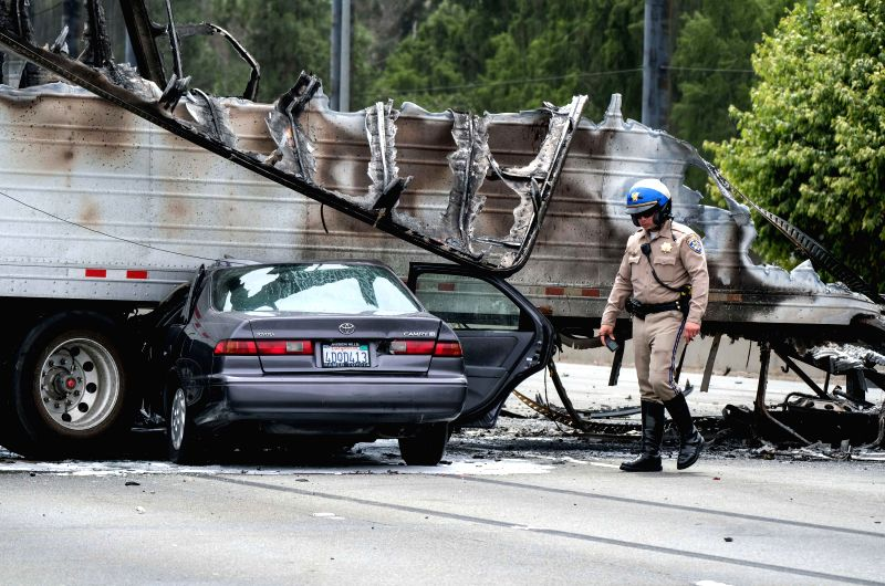 LOS ANGELES, April 26, 2017 - A policeman works at the scene after a multi-vehicle crashed on a freeway near the Griffith Park in Los Angeles, the United States, April 25, 2017. A fiery crash ...