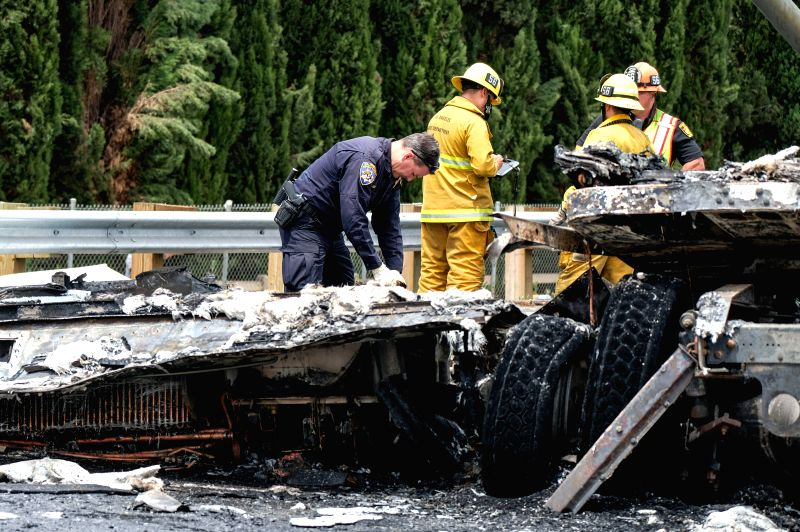 LOS ANGELES, April 26, 2017 - Firefighters work at the scene after a multi-vehicle crashed on a freeway near the Griffith Park in Los Angeles, the United States, April 25, 2017. A fiery crash ...