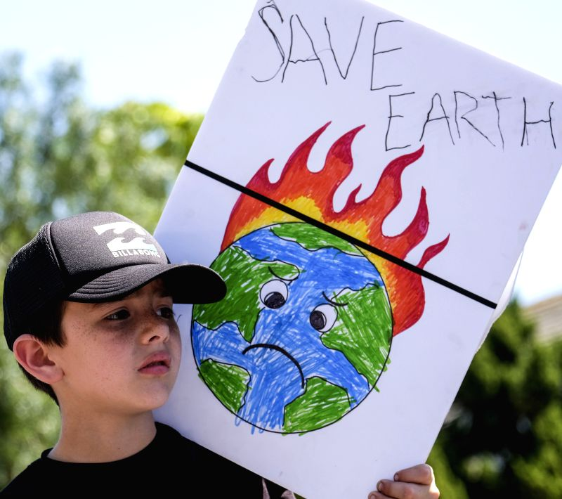 LOS ANGELES, April 30, 2017 - A child holds a placard during a demonstration against President Donald Trump's climate policies in Los Angeles, the United States, April 29, 2017. Huge crowds took to ...