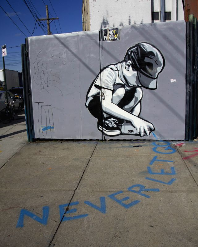 Photo taken on Nov. 14, 2014 shows graffiti in Brooklyn of New York City, the United States.
