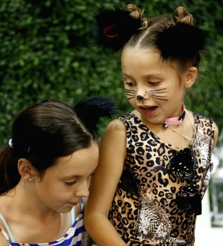 LOS ANGELES, Aug. 5, 2018 - Two girls attend the CatCon 2018 in Pasadena, Los Angeles County, the United States, Aug. 4, 2018. The two-day cat-centric pop culture event kicked off here Saturday.
