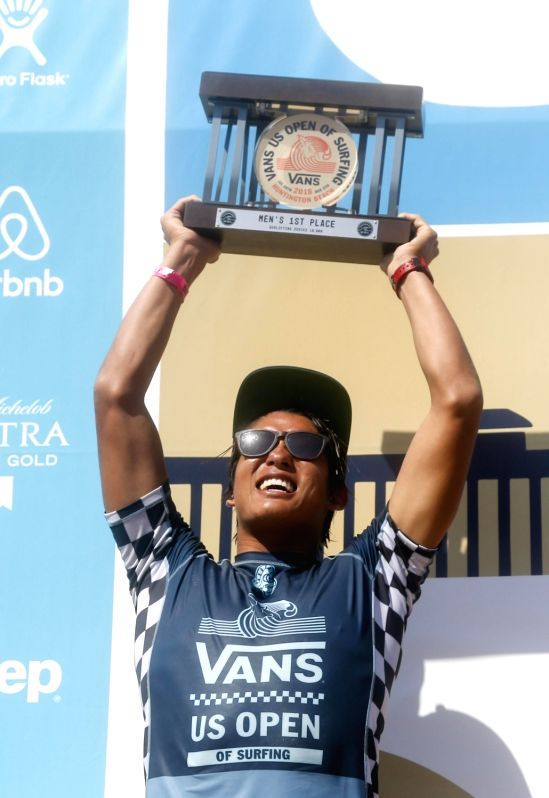 LOS ANGELES, Aug. 6, 2018 - Kanoa Igarashi of Japan celebrates on the podium after the men's final in the US Open Surfing in Los Angelels, the United States on Aug. 5, 2018. Igarashi won the title of ...