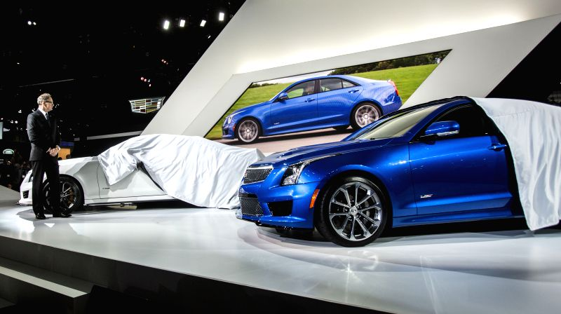 Los Angeles:  Cadillac President Johan de Nysschen unveils the new 2016 ATS-V sedan, and coupe during the media preview day at the 2014 Los Angeles Auto Show in Los Angeles, on Nov. 19, 2014. ...