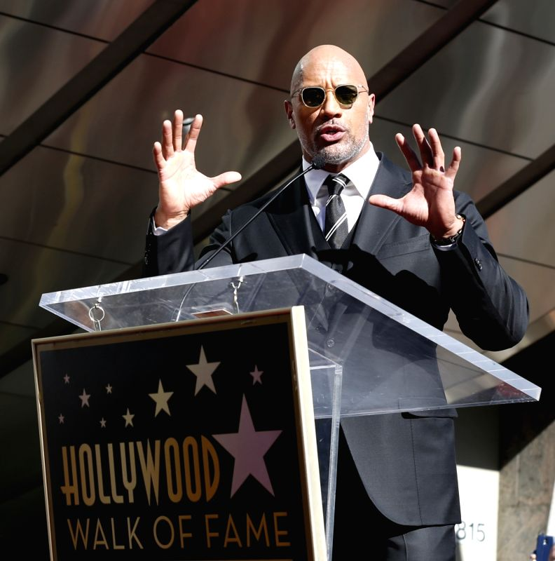 LOS ANGELES, Dec. 14, 2017 - Dwayne Johnson speaks at his Hollywood Walk of Fame Star ceremony in Los Angeles, the United States, Dec. 13, 2017. Dwayne Johnson was honored with a star on the ...(Image Source: Xinhua/Li Ying/IANS)