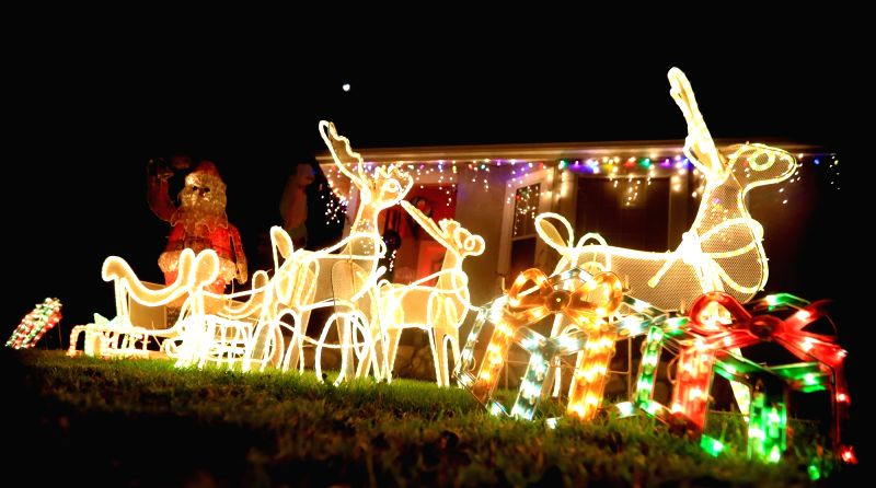 Christmas decorations and lights are seen in front of a house on Christmas eve in Los Angeles, the United States.