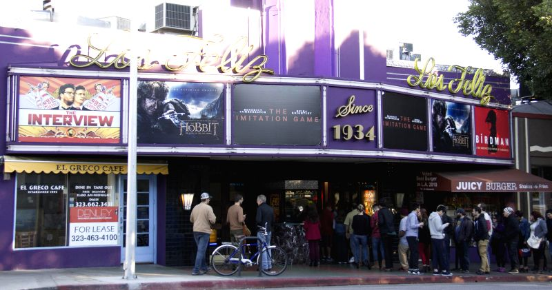 "Movie goers queue for ""The Interview"" at a theater in Los Angeles, Dec. 25, 2014. Sony Pictures Entertainment, which has captured much media attention"