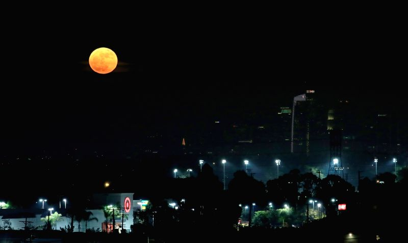 "LOS ANGELES, Dec. 4, 2017 - ""Supermoon"" rises over Los Angeles, the United States, Dec. 3, 2017. (Xinhua/Li Ying)"