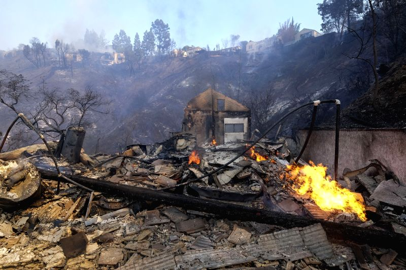 LOS ANGELES, Dec. 7, 2017 - A burnt house is seen at the Bel Air district of Los Angeles, the United States, Dec. 6, 2017. Los Angeles City Emergency Management Department on Wednesday night issued a ...