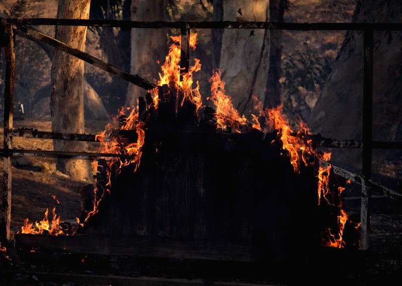 LOS ANGELES, Dec. 7, 2017 - Photo taken on Dec. 6, 2017 shows a burning house at the Bel Air district of Los Angeles, the United States. Los Angeles City Emergency Management Department on Wednesday ...