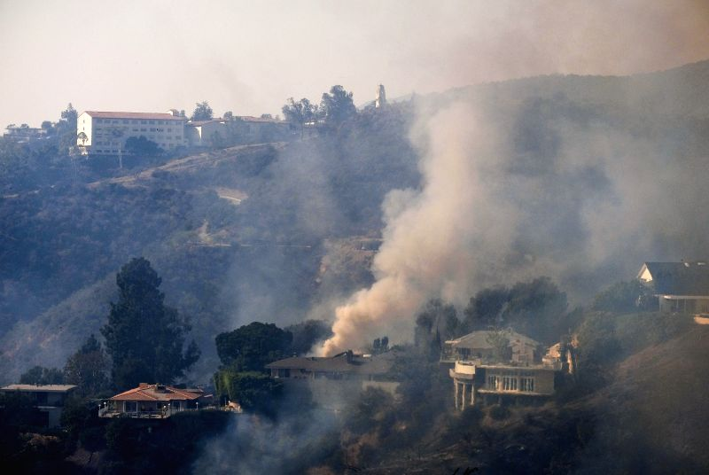 LOS ANGELES, Dec. 7, 2017 - Smoke rises from a wildfire at the Bel Air district of Los Angeles, the United States, Dec. 6, 2017. Los Angeles City Emergency Management Department on Wednesday night ...