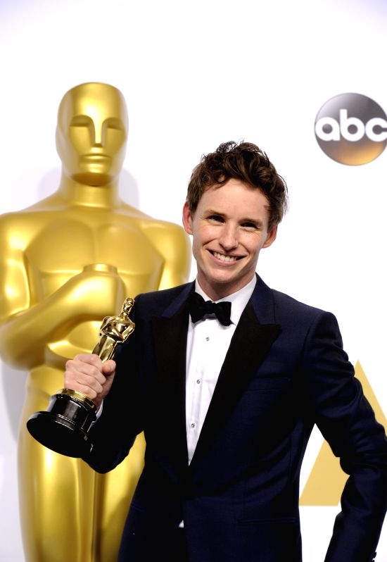 "Actor Eddie Redmayne poses after winning the Best Actor in a Leading Role award for ""The Theory of Everything"" during the 87th Academy Awards at the ... - Eddie Redmayne"