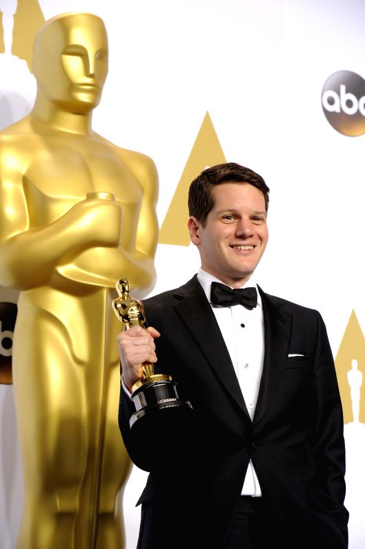 "Screenwriter Graham Moore poses after winning the Best Adapted Screenplay award for ""The Imitation Game"" during the 87th Academy Awards at the Dolby ..."