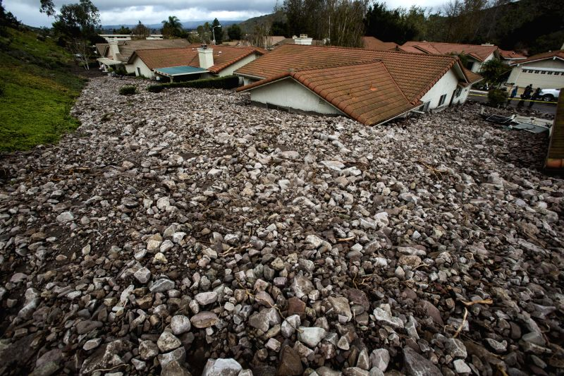 Los Angeles: Houses buried by rocks and debris are seen in Camarillo Springs, about 80km northwest to Los Angeles, California, the United States, Dec. 12, 2014. A soaking storm swept into Southern ...