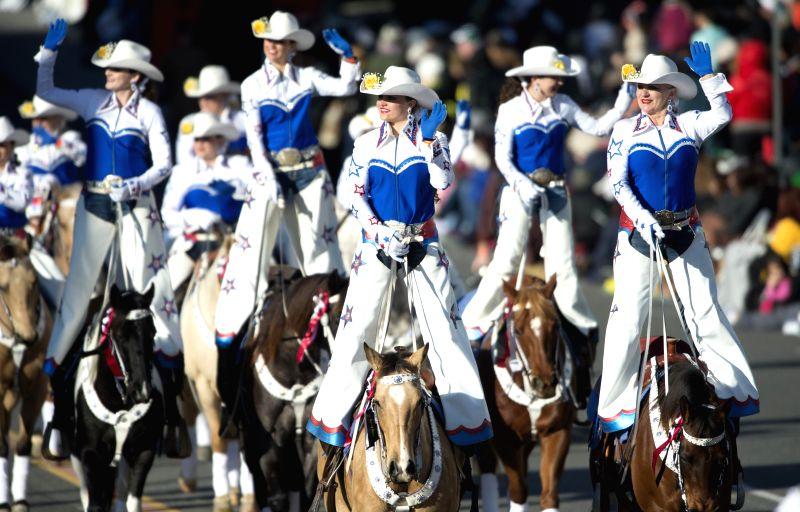 People march in the 126th Rose Parade in Pasadena, California, the United States on Jan. 1, 2015.