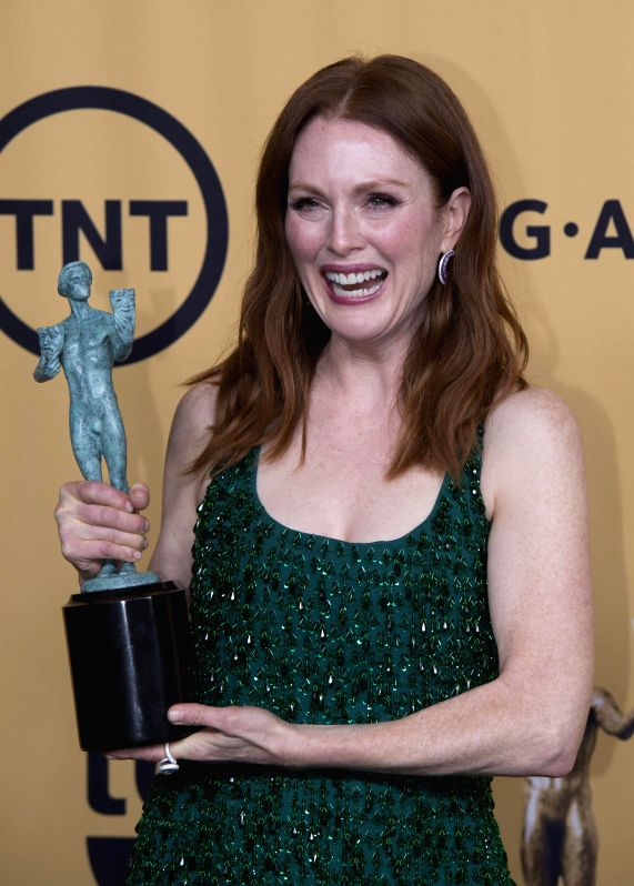 Actress Julianne Moore wins the Best Actress In Film at the 21st Annual Screen Actors Guild Awards at the Shrine Auditorium, in Los Angeles, California, on ... - Julianne Moore