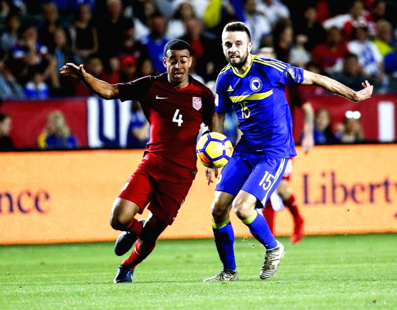 LOS ANGELES, Jan. 29, 2018 - Elvis Saric (R) of Bosnia and Herzegovina vies with Tyler Adams of the United States during an international friendly soccer match between the United States and Bosnia ...