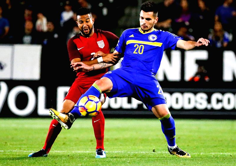 LOS ANGELES, Jan. 29, 2018 - Goran Zakaric (R) of Bosnia and Herzegovina vies with Justin Morrow of the United States during an international friendly soccer match between the United States and ...