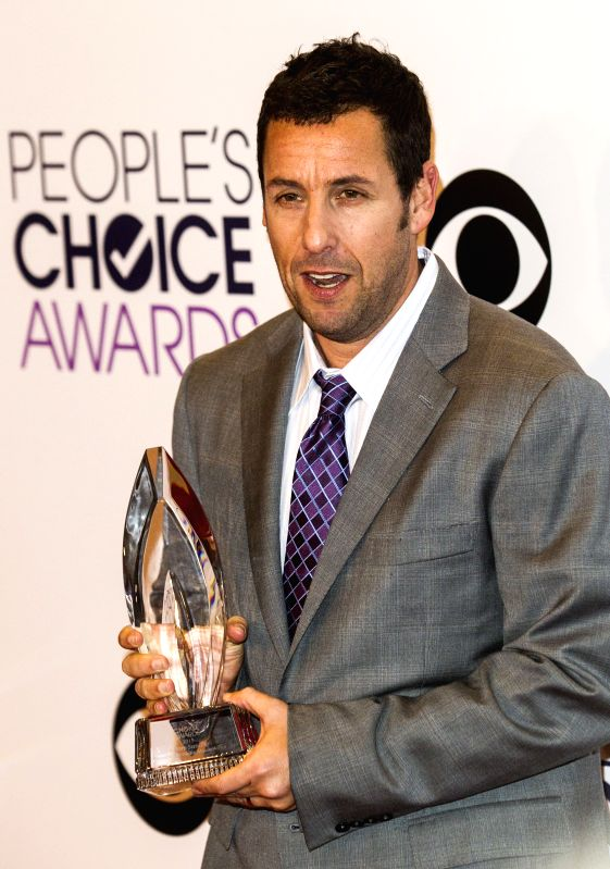 Actor Adam Sandler poses with the award for Favorite Comedic Movie Actor in the press room at the 41st Annual People's Choice Awards at Nokia Theatre in Los ... - Adam Sandler