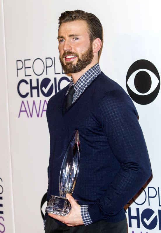 Actor Chris Evans poses with the award for favorite action movie actor in the press room at the 41st Annual People's Choice Awards at Nokia Theatre in Los ... - Chris Evans