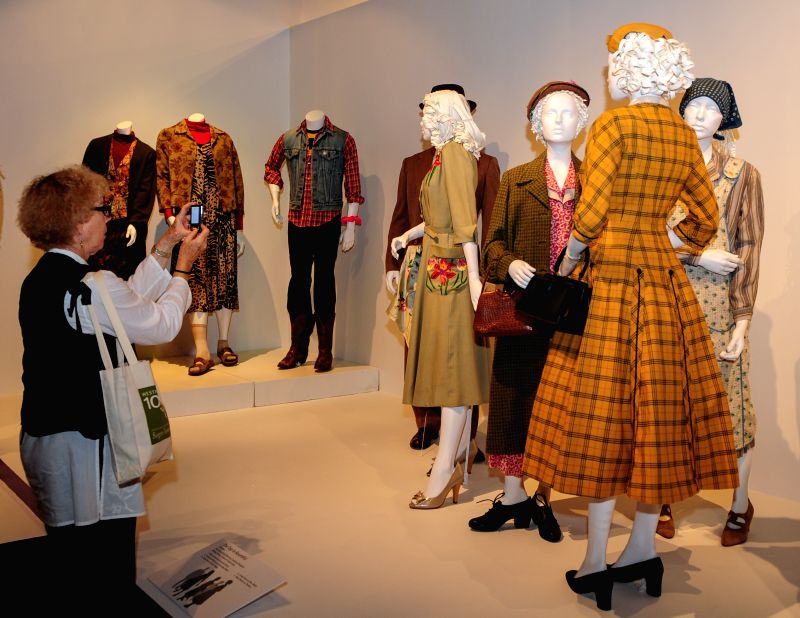 "A woman takes pictures for costumes in the TV show ""The Trip to Bountiful"" during the 8th annual exhibition of ""The Outstanding Art of Television"