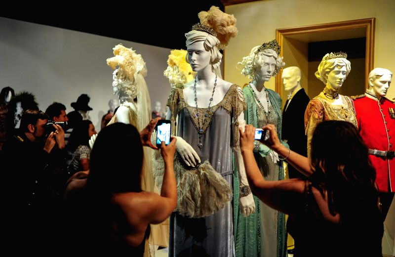 "People watch the costumes in the TV show ""Downton Abbey"" during the 8th annual exhibition of ""The Outstanding Art of Television Costume ..."